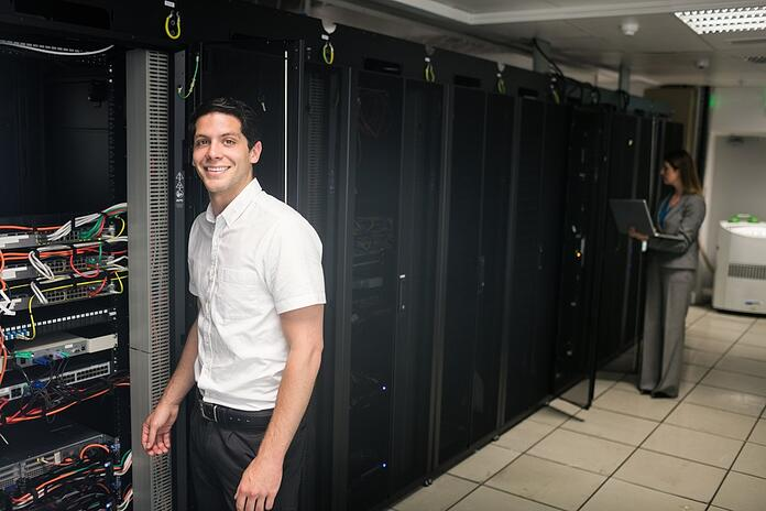 Team of technicians working on servers at the data centre.jpeg