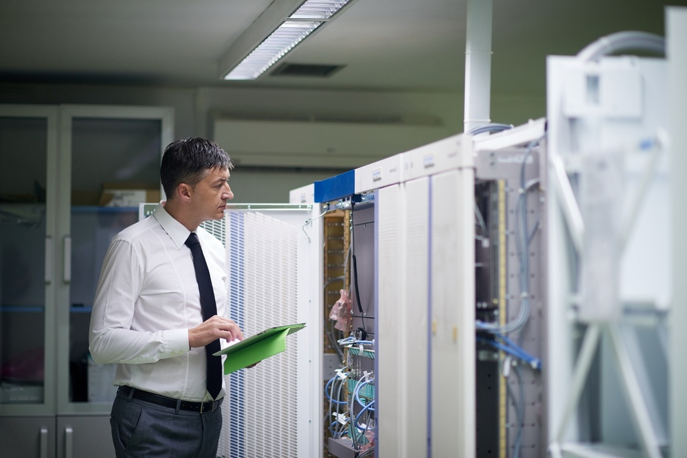 network engineer working in  server room, corporate business man working on tablet computer-1